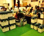 2019 Lok Sabha elections - Polling officials check EVMs