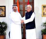 Salman Kurshid shakes hands with his United Arab of Emirates counterpart Sheikh Abdullah Bin Zayed Al Nahyan
