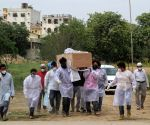 Family members carry the mortal remains of the  covid-affected victim for burial during the second wave of Covid-19 at Delhi gate graveyard  in New Delhi