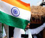 Farmer leader Rakesh Tikait addresses media against farmers' bill during Bharat Bandh by farmers in Ghazipur Border in New Delhi
