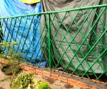 Free Photo:Farmer new way to avoid strong storm-rain, strengthened the boundary outside the tent with a paved wall.