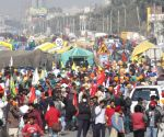 Thousands of protesting farmers march towards the national capital to lodge their protest over Centre's new agriculture laws