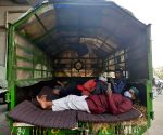 Free Photo: Farmers set up temporary houses in their tractors, sleep on wheat straw