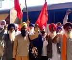 Farmers shout slogans before leaving in Train  for Delhi to continue their protest against the central government's recent agricultural reforms, at Railway Station in  Amritsar on Thursday 04th March, 2021.