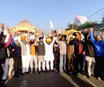 Farmers shout slogans as they take part in a demonstration and move towards Delhi to join the farmers who are continuing their protest against the central government's recent agricultural reforms in Amritsar