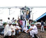:Farmers under the banner of Sanyukt Kisan Morcha (SKM) staging Rail roko on Modi Nagar