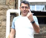 Kunal Kohli  shows his inked finger after casting her vote