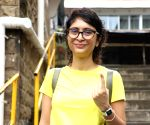 Kiran Rao shows her inked finger after casting her vote