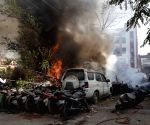 Fire fighter attempts to douse fire broke out from seize vehicles in Agamkuan Police station, in Patna, Friday, April 23, 2021
