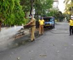 Kolkata: Fire fighters spraying disinfectants