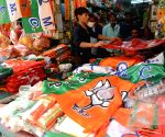 Flags, T-shirts and other things are being displayed to sell at a shop of various political parties, ahead of West Bengal's Assembly Elections in Kolkata on Saturday 06th March, 2021
