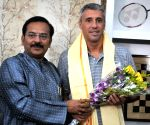 Former Argentinian footballer meets West Bengal Sports Minister