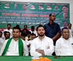 Tejashwi Yadav and Tej Pratap Yadav during a programme