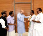Former Kerala PSC chairman Radhakrishnan joins BJP