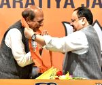 Former Railway Minister and Sr. TMC leader Dinesh Trivedi join BJP in the presence of national BJP president JP Nadda along  Piyush Goyal Minister of Railways, Union minister Dharmender Pradhan at BJP HQ in New Delhi on Saturday 06th March, 2021