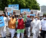 : Former Union Minister Vijay Goel with supporters demonstration against Delhi govt. for 1000 bus deal scandal at ITO Chowk in new Delhi on Saturday June 19, 2021