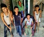 Free Photo: Four kids in family afflicted with polio
