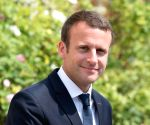 Macron says no comment on Trump's tweet attack