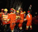 Rescuers work at the site of railway tunnel collapse in Funing County