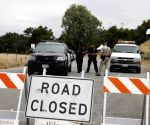 3 US policemen hurt, 1 suspect dead in car chase
