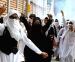 Girl students pelt stones on security personnel