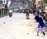 Girls pelt stones on security personnel