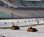 Ground staff at work at Eden Gardens