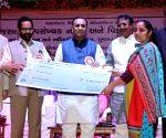 Cheque distribution programme - Vijay Rupani, Mukhtar Abbas Naqvi