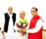Gujarat CM meets Narendra Singh Tomar, Parshottam Rupala