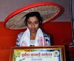 Assam Governor Janaki Ballav Patnaik felicitates Gunjan Sharma who volunteered herself as hostage to save 11 other students