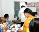 Free Photo: Gurumoorthy, Panabaka Lakshmi cast votes in Tirupati by-poll