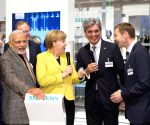 Hannover (Germany):  Modi, Merkel visit the Siemens AG booth at Hannover Messe 2015