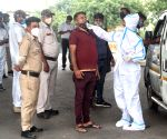Health worker collect swab sample for Covid-19 testing at Shastri park in New Delhi