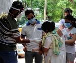 New Delhi : Health workers collect swab samples for Covid-19 testing at a testing center in New Delhi on Friday, May 07, 2021.