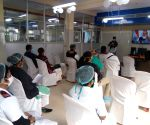 Health Workers watching PM Narendra Modi live before covid-19 vaccination drive at Salt Lake subdivision hospital
