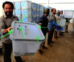 Staff of Afghan election commission unload ballot boxes from a truck