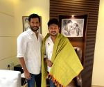 Hero Vishal accompanied by his friend Ramana met Tamil Nadu Chief Minister Elect DMK Chief MK Stalin and his son Udayanidhi Stalin.