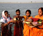 Hindu devotees perform rituar a part of Chaiti Chhath Puja prayers in river Ganga, amid rise in Covid-19 cases across the country, in Patna, Sunday, April 18, 2021
