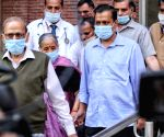 Hon'ble Chief Minister of Delhi Arvind Kejriwal with his mother and father coming out after receive the first dose of COVID-19 vaccine at LNJP Hospital