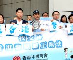 Calls to boycott 'Mulan' after star backs HK police
