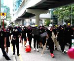 HK police block Sunday protest march against mask ban