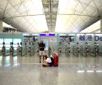 HK airport to close concourse as flights plummet