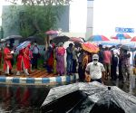 JHuge number of people are standing in the line during the rain for Covid vaccination outside of Kishore Bharati Stadium  in Kolkata.