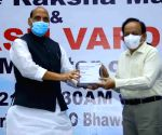 Hyderabad : Defence  Minister Rajnath Singh unveils first batch of anti-COVID drug developed by DRDO and hands over to Health Minister Dr Harsh Vardhan in Hyderabad.
