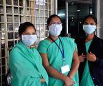 Hospital staff wear masks to avoid contracting swine flu