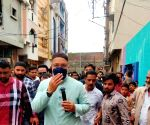 Owaisi during door-to-door campaign for GHMC elections