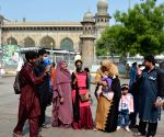 Hyderabad : Muslims exchange of greetings near Charminar macca masjed background Hyderabad police commissioner Anjani kumar greeted at Charminar in Hyderabad.