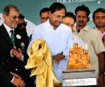 KCR unveils Golconda Masters Golf Championship Trophy