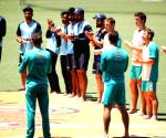 Free Photo:  India, Aus players take part in 'barefoot circle' ceremony against racism
