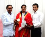 K Chandrasekhar Rao presents Rs Five Crore to P.V. Sindhu